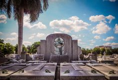 Tombstone at a cemetery in Havana. Tombstone at the colon cemetery in Havana with a Palm in sunshine Stock Images