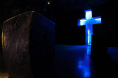 Tombstone and cross with blue light in salt Stock Photos