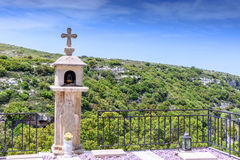 Tombstone cross on the grave with a beautiful view of the mountain and clouds Royalty Free Stock Photos