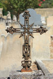 Tombstone with cross ornament at a French cemetery Royalty Free Stock Images