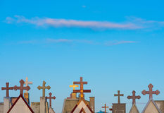 Tombstone crosses against blue sky Royalty Free Stock Image