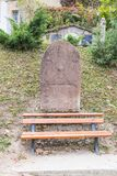 Tombstone with an erased inscription on the old cemetery located in the castle in Old City. Sighisoara city in Romania stock image