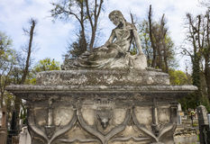 Tombstone with female sculpture and the Cross Royalty Free Stock Image