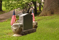 Tombstone with flags Royalty Free Stock Image