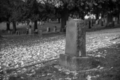Tombstone and graves in graveyard landscape,black and white. Stock Photos