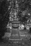 Tombstone and graves in graveyard landscape,black and white. Royalty Free Stock Photo