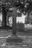 Tombstone and graves in graveyard landscape,black and white. Royalty Free Stock Image