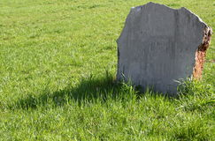Tombstone on a green lawn. A clean tombstone on a green lawn Stock Photography