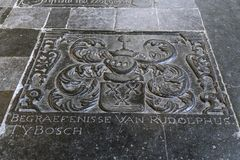 Tombstone from the Middle Ages in historic church. Tombstones with historic heraldic shields in beautiful medieval cathedral royalty free stock image