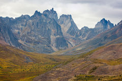 Tombstone Mountain range Yukon Territory Canada. Autumn fall colors start to arrive in Tombstone Territorial Park near Dempster Highway north of Dawson City Royalty Free Stock Photos