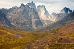 Tombstone Mountain range Yukon Territory Canada. Autumn fall colors start to arrive in Tombstone Territorial Park near Dempster Highway north of Dawson City Stock Image