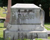 Tombstone with the name Risk on it. Grave marker in cemetery with the last name Risk on it Royalty Free Stock Images
