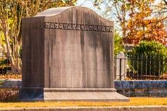 Tombstone on Oakland Cemetery, Atlanta, USA. The concrete tombstone closeup on the Oakland Cemetery in sunny autumn day, Atlanta, USA Royalty Free Stock Photo