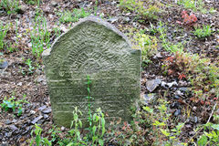 Tombstone on the old village Jewish Cemetery Royalty Free Stock Photography