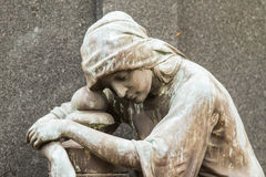Tombstone sculpture. Of a mourner woman Stock Photo