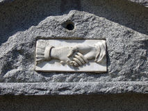 Tombstone with Shaking Hands Stock Image