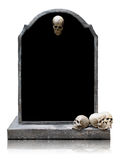 Tombstone with skull isolated with clipping path. Tombstone with skull isolated on white background, copy space and clipping path stock images