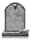 Tombstone with skull isolated with clipping path. Tombstone with skull isolated on white background, copy space and clipping path royalty free stock photo