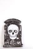 Tombstone with skull  on white background, Stock Photo