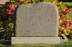 Tombstone with sunlight from the right side Royalty Free Stock Image