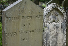 Tombstone of William Wordsworth in Grasmere. Grasmere, England - May 30, 2012: In the cemetery of the Saint Oswald Church stands the gray old tombstone of the Stock Image