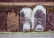 Tombstones. Three ancient noname gravestones in old London cathedral Royalty Free Stock Image