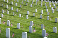 Tombstones at Arlington National Cemetery on Memorial Day. Rows of tombstones with American flags at Arlington National Cemetery on Memorial Day Stock Photo