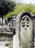 Tombstones in cemetery at dusk, gothic style crosses noone Royalty Free Stock Photo