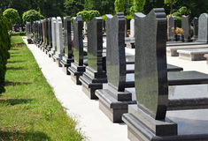 Tombstones in the cemetery Royalty Free Stock Photos