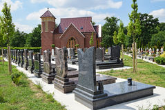 Tombstones and a chapel Royalty Free Stock Image