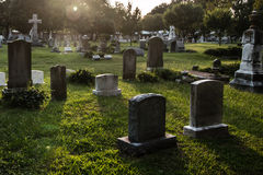 Tombstones at Dusk. Tombstones in a cemetery at dusk Royalty Free Stock Photography