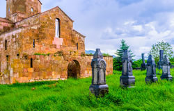 The tombstones in grass. The black carved tombstones next to Odzun Basilica, Alaverdi, Armenia Stock Photography