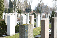 Graveyard. Tombstones on a graveyard on a sunny day Royalty Free Stock Images