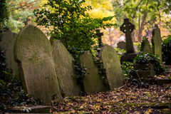 Tombstones of Highgate Cemetery, London. Leaned old tombstones at the Highgate Cemetery, London famous for Karl Marx grave Stock Image