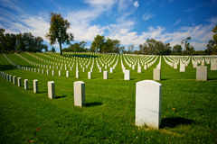 Tombstones Markers in LA National Cemetery. Tombstones of American soldiers cover a hillside in Los Angeles National Cemetery in sunny California Royalty Free Stock Photo