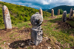 Tombstones. Medieval tombstones in the mountains Stock Photography