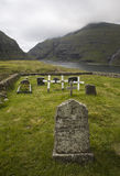 Tombstones in the nature. Churchyard at Saksun. Faereo Island royalty free stock photography