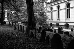 Tombstones in old grave yard three. One of the oldest graveyards in america is in boston massachusetts, here is a scene from king's chapel cemetery  black and Royalty Free Stock Image