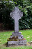 Cross tombstone at a graveyard. A tombstones in the shape of a cross Royalty Free Stock Photo