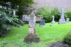 Cross tombstones at a graveyard Stock Image