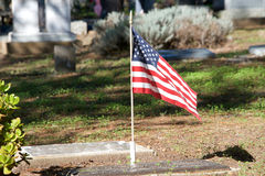 Tombstones with solitary American Flag Royalty Free Stock Photos