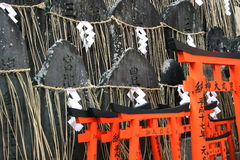 Tombstones and Tori. (gates) at a shrine in Kyoto, Japan Stock Photos