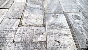 Tombstones used as floor tiles at the Monastery of the Mother of God, Istanbul Royalty Free Stock Photos