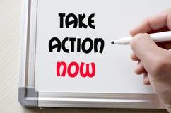 Tome a ação escrita agora no whiteboard Fotografia de Stock Royalty Free
