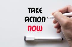 Tome a ação escrita agora no whiteboard Fotografia de Stock