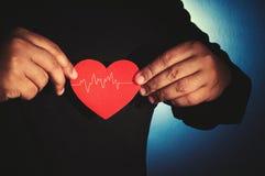 Tome a cuidado su corazón Imagenes de archivo