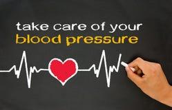 Tome el cuidado de su presión arterial Imágenes de archivo libres de regalías