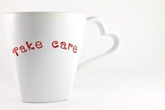 Tome la palabra del cuidado en una taza del amante de café Fotos de archivo libres de regalías