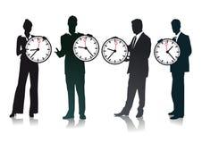 Tome tiempo: hombres de negocios que sostienen los relojes Imagen de archivo libre de regalías