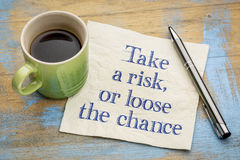 Tome um risco ou afrouxe a possibilidade - conceito do guardanapo Imagem de Stock